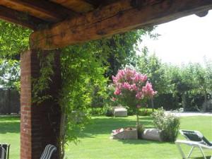 porxe barbacoa jardí casa rural piscina